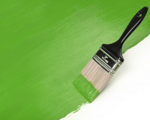 Paintbrush with green paint with Copy Space